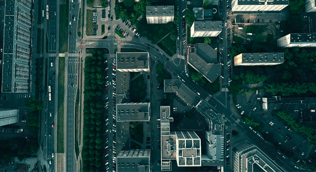 Aerial view of a city with buildings and roads.